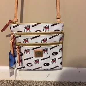 Dooney & Bourke adjustable cross body bag.